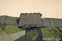 The mag pouch attached to a belt.