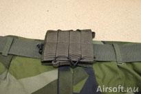 Vill man inte ha magasinfickan i en väst kan man ha det vågrätt fastsatt i ett bälte, fungerar bäst på bälten som är 45 mm breda.