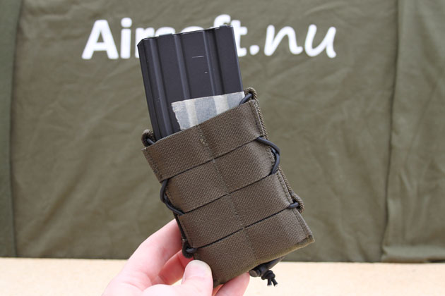 The magazine pouch is made of olivedrab 1000D Cordura fabric with MOLLE interface on the outsides and black elastic cord which keeps all together.