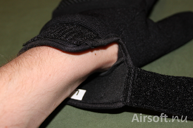 Around the wrist the material is neprene and it's attached with velcro.